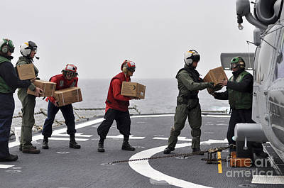 Sailors Load Boxes Of Food Onto An Print by Stocktrek Images