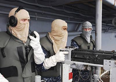 Obscured Face Photograph - Sailors Man A .50 Caliber Gun Mount by Stocktrek Images