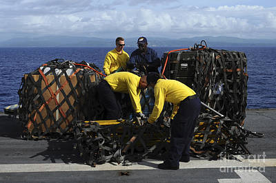 Netting Photograph - Sailors Prepare Pallets Of Cargo Aboard by Stocktrek Images