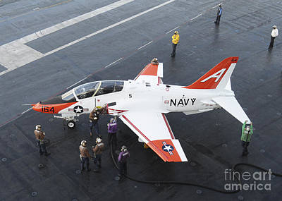 Trainer Aircraft Photograph - Sailors Refuel A T-45 Goshawk by Stocktrek Images