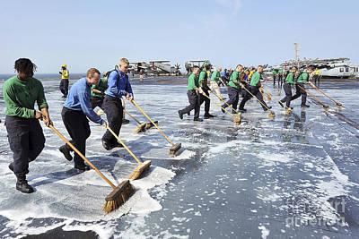 Sailors Scrub Down The Flight Deck Art Print by Stocktrek Images