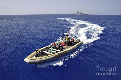 Inflatable Photograph - Sailors Transit An Inflatable Boat by Stocktrek Images