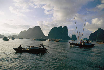 Junks Etc Photograph - Sampans Ply The Placid Waters Of Halong by Steve Raymer