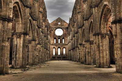 San Galgano  - A Ruin Of An Old Monastery With No Roof Art Print by Joana Kruse