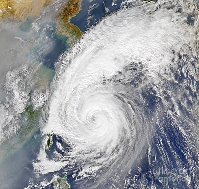 Photograph - Satellite Image Of A Typhoon by Stocktrek Images