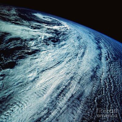 Satellite Images Of Storm Patterns Art Print by Stocktrek Images
