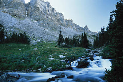 Beartooth Mountain Range Photograph - Scenic Stream Running Through A Valley by Kate Thompson