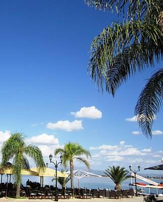 Photograph - Seaside Bay Cafe Blue Sky And Sun Umbrellas In Nafplion Greece by John Shiron