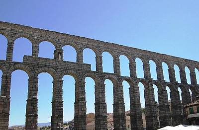 Photograph - Segovia Ancient Roman Aqueduct Architectural Granite Stone Structure Ix With Arches In Sky Spain by John Shiron
