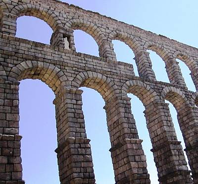 Photograph - Segovia Ancient Roman Aqueduct Architectural Granite Stone Structure Vii With Arches In Sky Spain by John Shiron