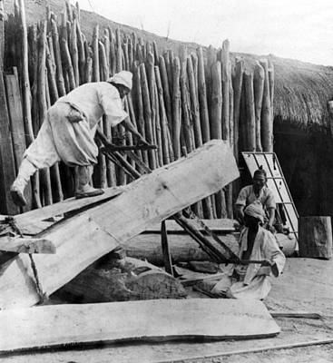 Photograph - Seoul Korea - Men Sawing Lumber by International  Images