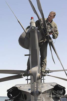 Sergeant Inspects An Hh-60 Pave Hawk Art Print