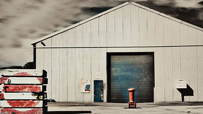 Shed With Bollard And Pallets Art Print by Harry Neelam