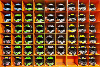 Shelves Filled With Helmets For Hire Print by Corepics