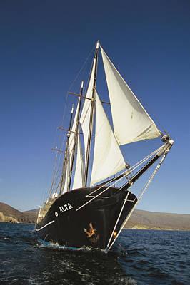 Ship Sailing Through The Galapagos Print by Steve Winter