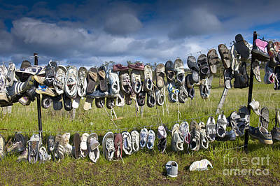 Shoes Hanging On Fence Art Print by Jacobs Stock Photography