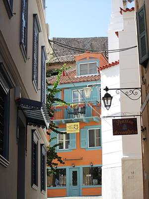 Photograph - Side Street View Of A Building And Lamp Post In Nafplion Greece by John Shiron