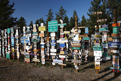 Typographic World Royalty Free Images - Sign posts forest in Watson Lake Yukon Royalty-Free Image by Mark Duffy