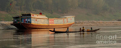 Boat Along The River Photograph - Silence On The Mekong by Bob Christopher