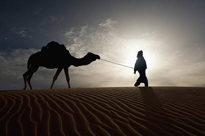Berber Man Photograph - Silhouette Of Berber Leading Camel by Axiom Photographic