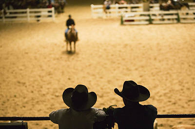 Of Rodeo Events Photograph - Silhouette Of Cowboys At Indoor Rodeo by Walter Bibikow