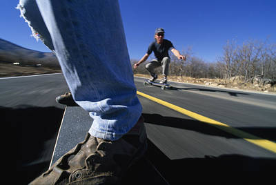 Skateboarders On A Smooth Road Art Print