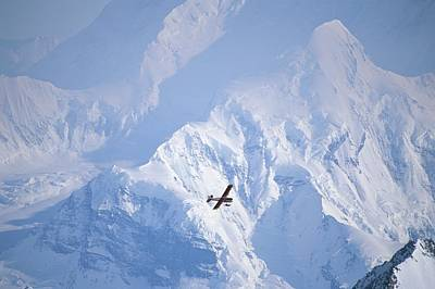 Natural Forces Photograph - Skiplane Winging Over Mount Saint Elias by Michael Melford