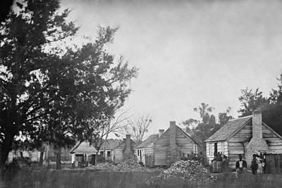 Slaves Sitting Near Their Cabins Art Print by Everett