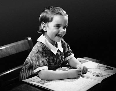 Smiling Young Girl Reading Book Art Print by George Marks