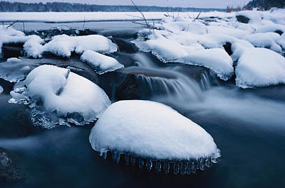 Itasca State Park Photograph - Snow And Ice Coved Rocks In Lake Itasca by James L. Stanfield