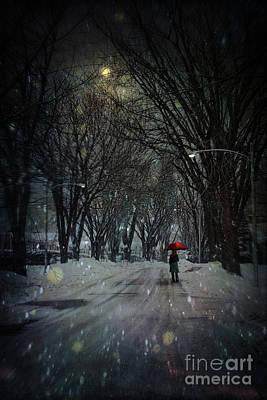 Snowy Winter Scene With Woman Walking At Night Art Print by Sandra Cunningham