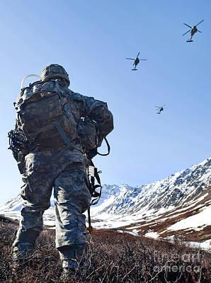 Soldier Patrols Through Alaska's Art Print by Stocktrek Images