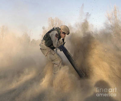 Soldier Plugs His Ears While Firing Art Print by Stocktrek Images