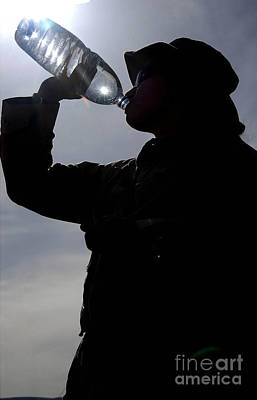 Videographer Photograph - Soldier Takes A Long Drink Of Bottled by Stocktrek Images