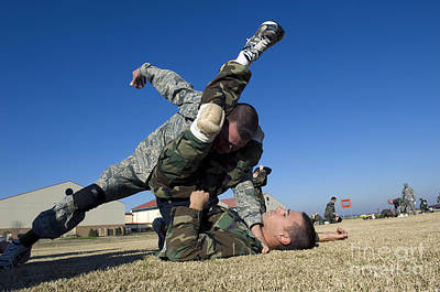 Soldiers Demonstrate Proper Grappling Art Print by Stocktrek Images