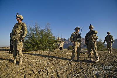 Soldiers Discuss A Strategic Plan Art Print by Stocktrek Images