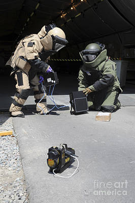 Obscured Face Photograph - Soldiers Dressed In Bomb Suits Examine by Stocktrek Images