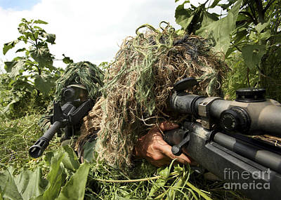 Blending Photograph - Soldiers Dressed In Ghillie Suits by Stocktrek Images