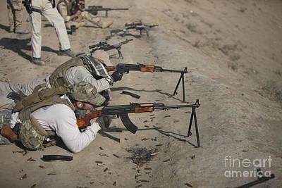Kalashnikov Photograph - Soldiers Fire A Russian Rpk Kalashnikov by Terry Moore