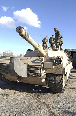 Photograph - Soldiers Get Their Battletank Ready by Stocktrek Images