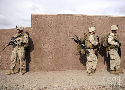 Photograph - Soldiers Halt Behind A Wall Moments by Stocktrek Images