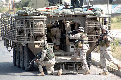 Soldiers Load In To The Stryker Armored Art Print