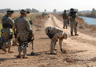 Improvised Explosive Device Photograph - Soldiers Secure An Improvised Explosive by Stocktrek Images