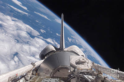 Photograph - Space Shuttle Discovery Backdropped by Stocktrek Images