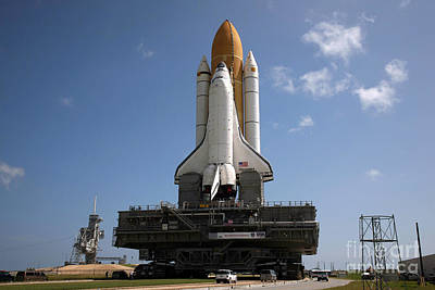 Photograph - Space Shuttle Discovery Makes Its Way by Stocktrek Images