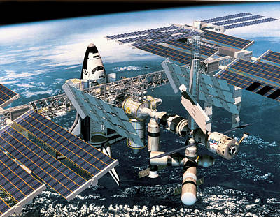 Space Shuttle Docked At The Space Station In Outer Space Art Print by Stockbyte