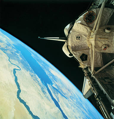 Satellite View Photograph - Space Shuttle Orbiting The Earth by Stockbyte