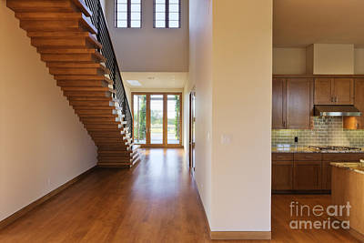 Spacious Hallway Showing A Staircase And Modern Kitchen Art Print by Jeremy Woodhouse
