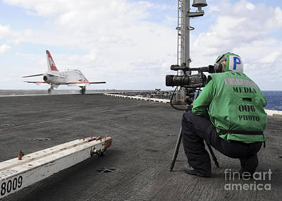Videographer Photograph - Specialist Records Video Of Flight Deck by Stocktrek Images
