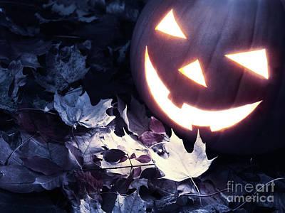 Spooky Jack-o-lantern On Fallen Leaves Art Print